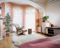 Утеплений балкон можна об'єднати з кімнатою
