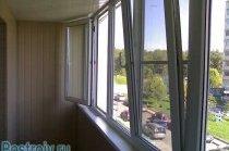 Утеплений балкон з пластиковими вікнами - Фото